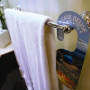 """Stop listening to donors   image of hand towel on rack with """"please reuse"""" sign"""